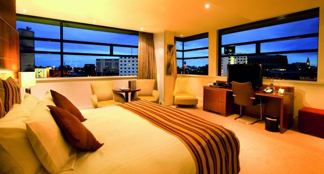 Bedroom with a panoramic view at dusk at Macdonald Manchester Hotel & Spa NCN